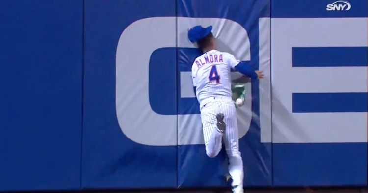Albert Almora Jr. was forced to exit the game after colliding with the outfield wall.