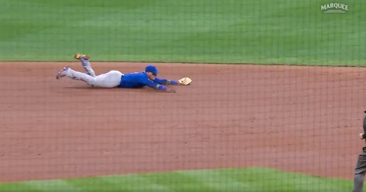 Cubs shortstop Javier Baez laid out and made a tremendous diving stop before flipping the ball to second base.