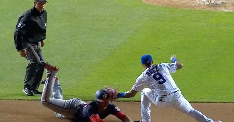 Javier Baez's no-look tag provided Willson Contreras with his fourth caught stealing of the season.