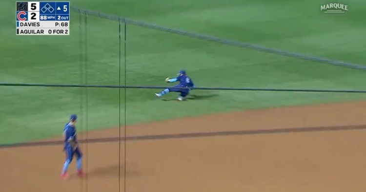 """Sliding across the outfield grass and cleanly fielding a hard-hit grounder, """"El Mago"""" pulled off a magical defensive highlight."""