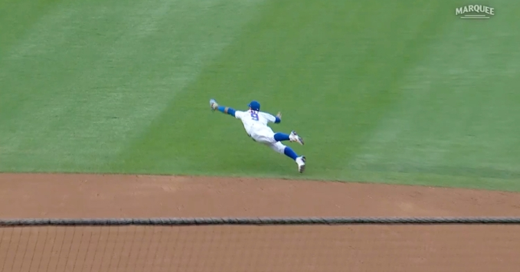 """Going airborne, Javier """"El Mago"""" Baez went all out in pulling off a breathtaking defensive feat."""