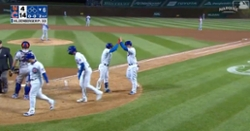 WATCH: Javier Baez lofts grand slam into night sky at Wrigley Field
