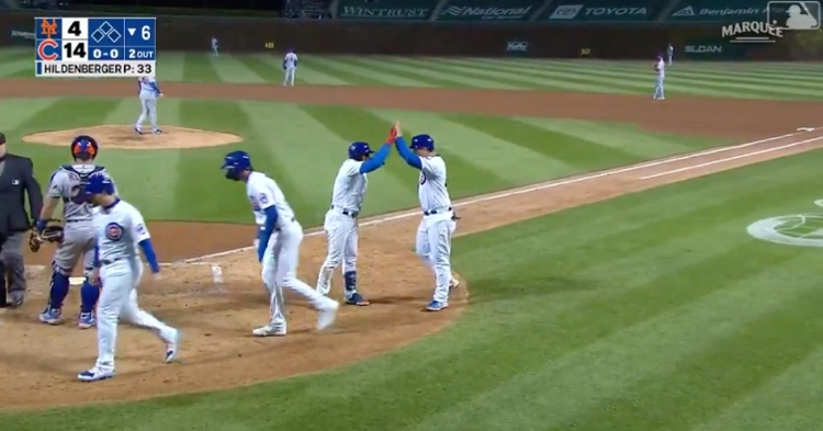 Leaving the bat at 103.9 mph and 29 degrees, Javier Baez's grand slam made the score 14-4 in favor of the Cubs.