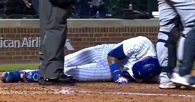Javier Baez dropped to the dirt in excruciating pain after getting beaned.