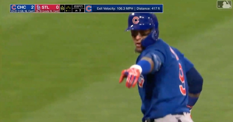 Javier Baez appeared to playfully taunt some onlooking Cardinals fans after crossing the plate.