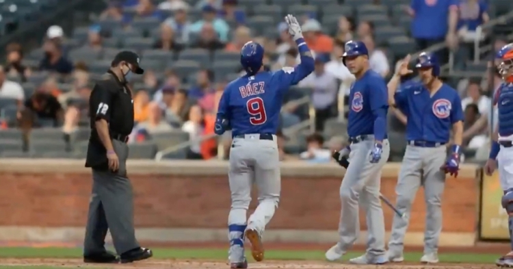 Driving a two-run bomb over the wall in right-center field, Javier Baez tabbed his 15th home run of the year.