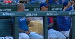 WATCH: Javier Baez eats from giant bag of popcorn in dugout