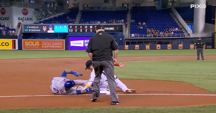 Mets second baseman Javier Baez went all out when avoiding a tag and scored a run soon afterward.