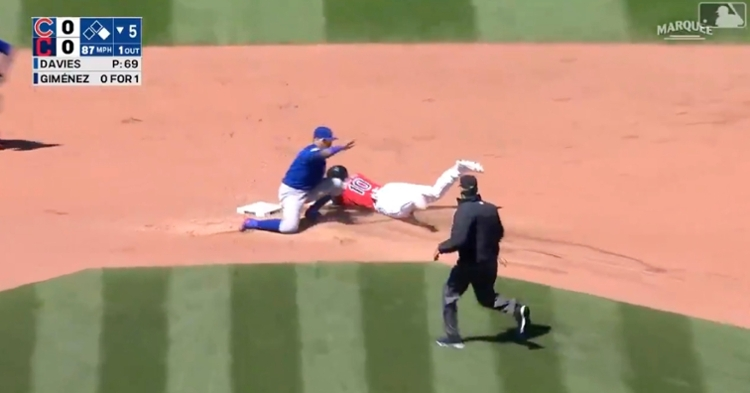 """Javier Baez applied a no-look tag as part of a """"strike 'em out, throw 'em out"""" double play."""
