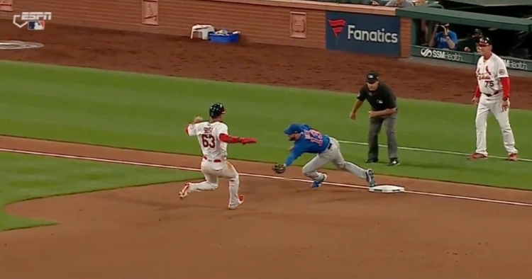 Phil Cuzzi somehow thought that David Bote was no longer on the bag when he made this catch.