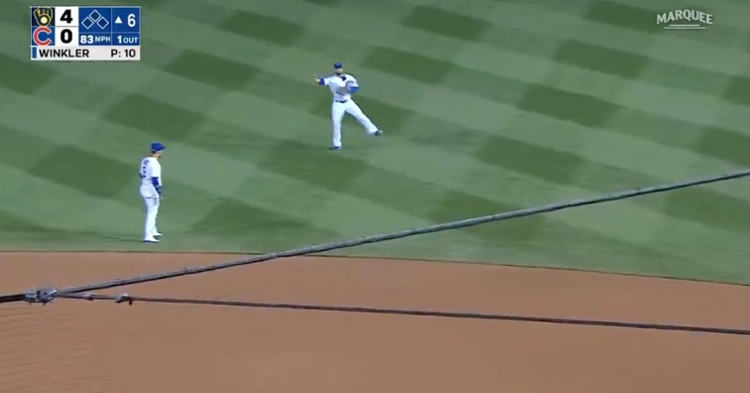 Cubs second baseman David Bote made a superb throw across his body, resulting in an out.