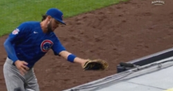 WATCH: Kris Bryant's momentum carries him into dugout while he catches foul ball