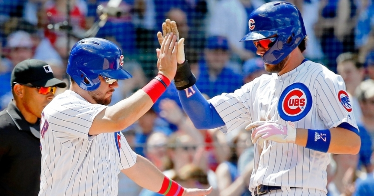Kris Bryant gifted Kyle Schwarber with a handful of candy in Schwarber's return to the Friendly Confines. (Credit: Jon Durr-USA TODAY Sports)