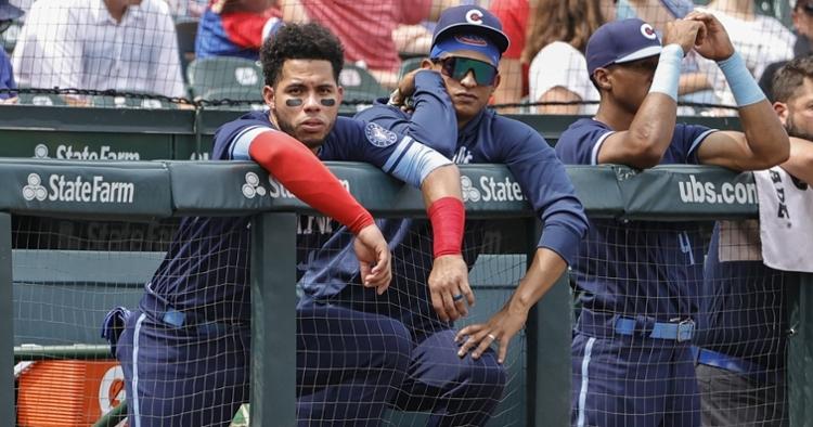 Contreras and Alzolay watch from the dugout (Kamil Krzaczynski - USA Today Sports)