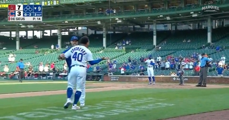 Willson Contreras charged onto the field in order to confront Pat Hoberg and was restrained by David Ross.