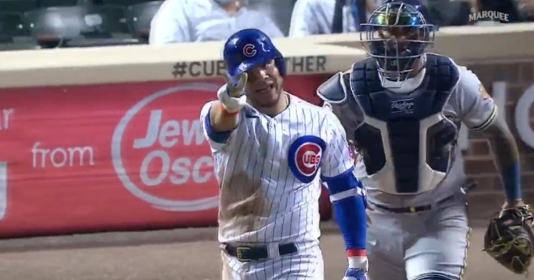 Willson Contreras held up two fingers to indicate how many times he had been hit two games into the series.