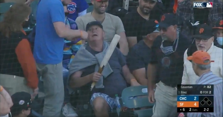 A fan at Saturday's Cubs-Giants game collected a souvenir by hauling in the barrel of Javier Baez's broken bat.