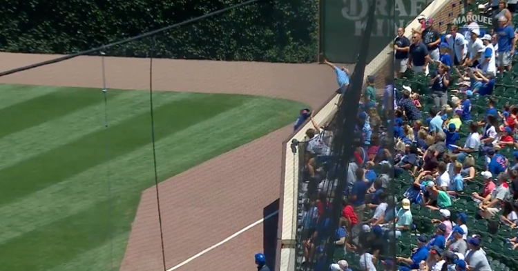 Jason Heyward was in position to catch a fly ball near the padded wall down the right field line when an overeager fan reached out and caught it himself.