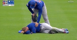 WATCH: Ian Happ carted off field after colliding with Nico Hoerner