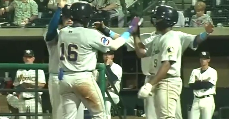 Made celebrates with his teammates after his first homer