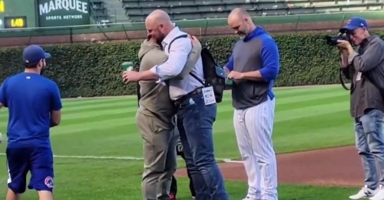 Contreras hugs Lester after getting a new Rolex