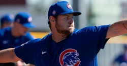 Cubs place reliever on 10-day IL, call up lefty pitcher