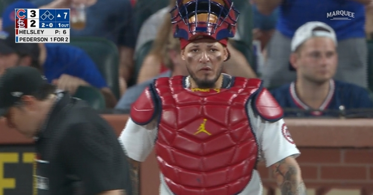 Yadier Molina's off-the-mark throw to third base proved costly for the Cardinals. (Credit: @WatchMarquee on Twitter)