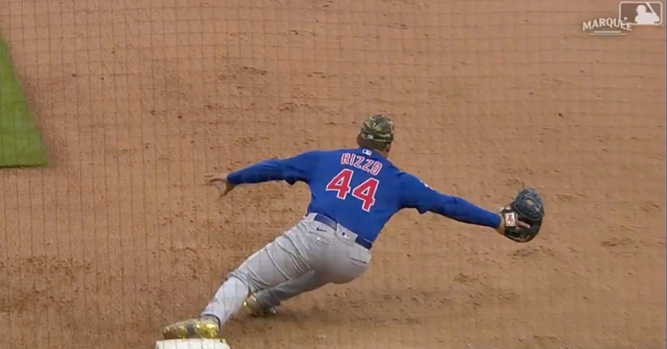 Anthony Rizzo fully extended in order to make a catch at first base that bailed out Javier Baez.