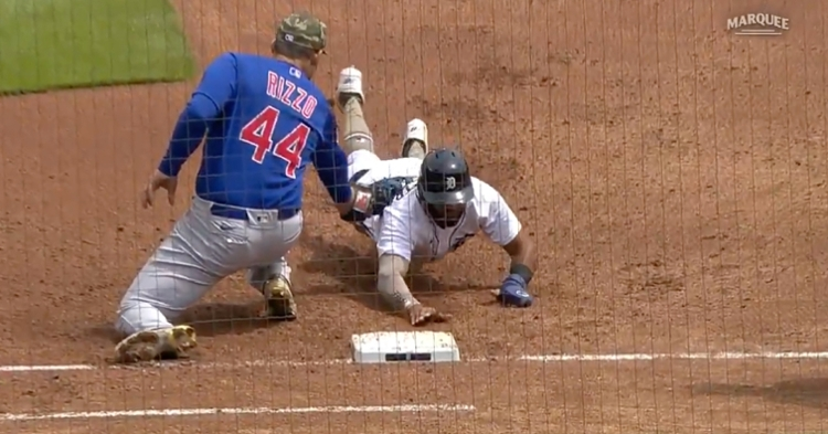 Anthony Rizzo completed a pickoff at first base by tagging out Willi Castro as he dived back toward the bag.