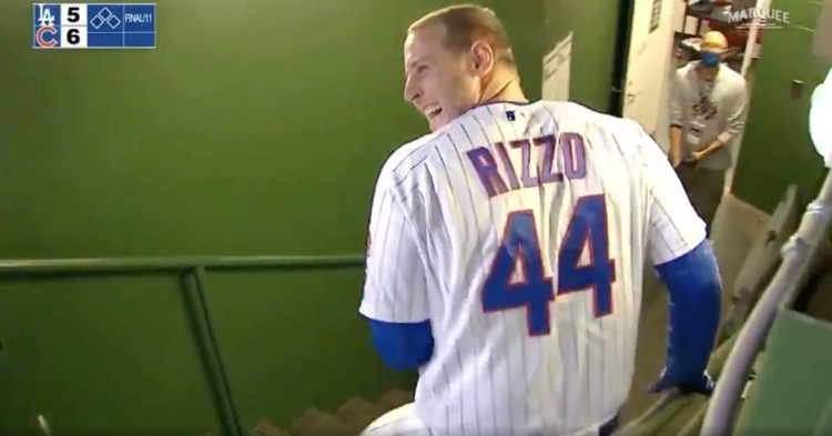 Anthony Rizzo did not wait around to be pounced on and doused in water by his rowdy teammates.