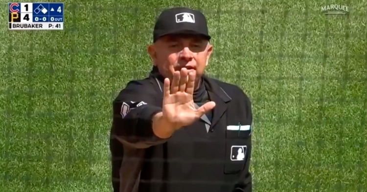 Umpire Greg Gibson threw Cubs catching coach Mike Borzello out of Sunday's game.