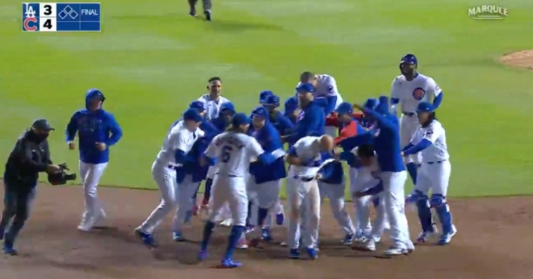 David Bote celebrated with his teammates after winning the game for the Cubs via a walkoff single.