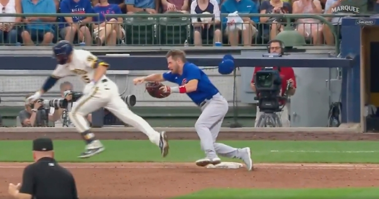 A baserunner collided with Patrick Wisdom at first base, resulting in Wisdom being removed from the game.