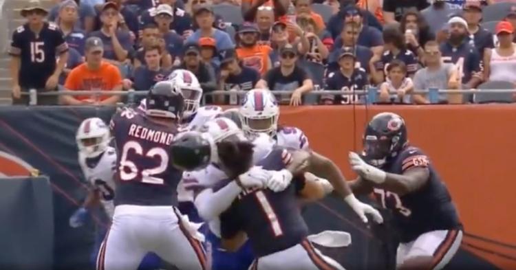 Bears quarterback Justin Fields' helmet went flying when Bills linebacker Andre Smith hit him high on a sack.
