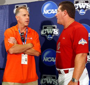 Clemson's Jack Leggett and USC's Ray Tanner share some thoughts before a CWS press conference last week.