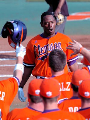 The Tigers celebrate Chris Epps' homer that led off the season.