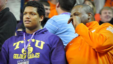 Isaac Rochell with his Clemson recruiter Marion Hobby.