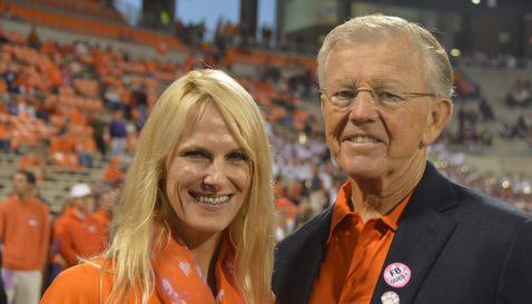 Joe Gibbs with Dabo Swinney's sister-in-law Tammy before the game