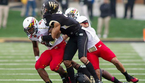 Wide receiver Deon Long (right) was injured on this play against Wake Forest (Photo: Jeremy Brevard)