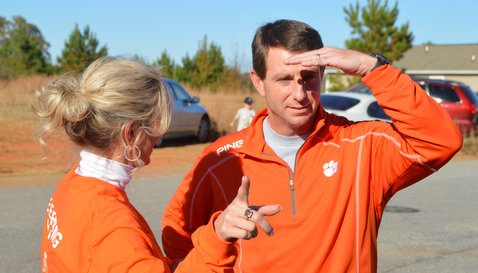 Swinney, shown here at the team community function Friday, says there are no cons with early signing period