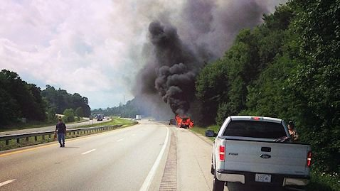 Photo of the burning car from Tig Willard.