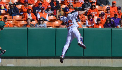 Garrett Boulware goes airborne to catch an errant throw in the third inning Sunday
