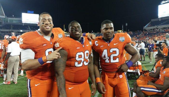 Williams (center) celebrates with Josh Watson and Stephone Anthony Monday