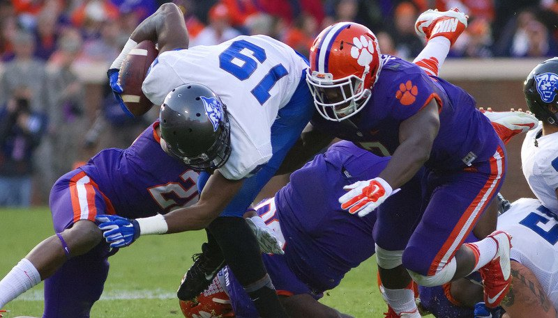 Clemson's defense swarms to the ball against Georgia St. (Photo by Joshua S. Kelly)