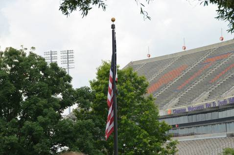 The flag at the Clemson Scroll of Honor Memorial sits in the shadow of Death Valley