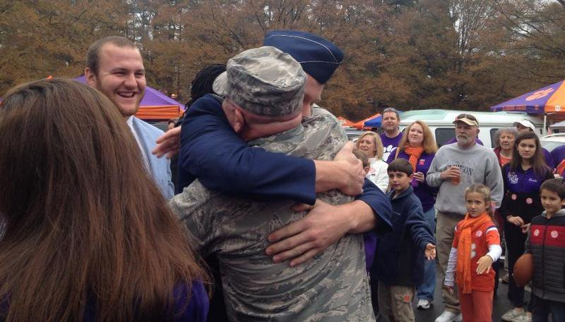 Sean Mac Lain hugs Michael as Eric looks on during TigerWalk last season