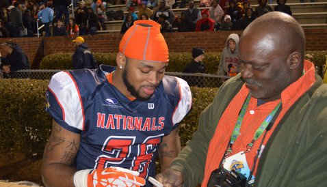 McDowell signs an autograph for a Clemson fan following Friday's game