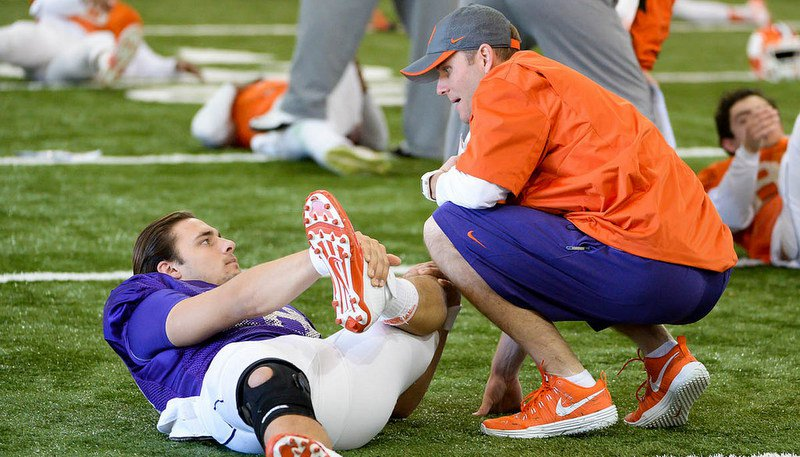 Brandon Streeter talks to Cole Stoudt during Saturday's practice
