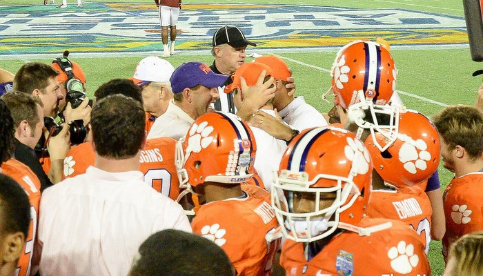Swinney was able to celebrate with Scott and Elliott after the win over Oklahoma