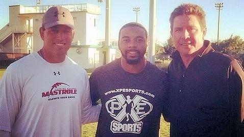 Tajh Boyd with Ken Mastrole and Dan Marino.  <span style=